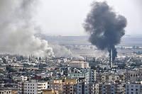 La fumee s'eleve au-dessus de la ville syrienne de Ras al-Ain le 16 octobre 2019.