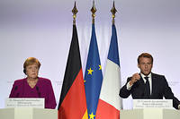French President Emmanuel Macron (R) speaks next to German Chancellor Angela Merkel during a joint press conference, one day before a key EU summit that may approve a divorce deal with Britain, in Toulouse, southwestern France, on October 16, 2019. (Photo by Pascal PAVANI / AFP)