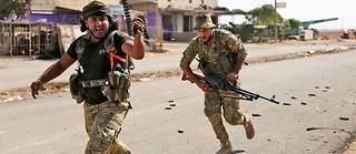 Ras al-Aïn (Syrie), le 14octobre. Des milliers de mercenaires islamistes syriens se sont joints à l'offensive armée des forces turques dans l'enclave kurde du nord-est de la Syrie.  ©NAZEER AL-KHATIB