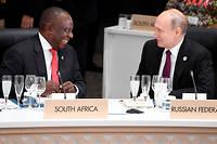 La Russie noue de plus en plus de liens avec l'Afrique. Ici, les presidents sud africain Cyril Ramaphosa et russe Vladimir Poutine au G20 d'Osaka, au Japon, en 2019.