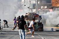 Des manifestants protestent contre le gouvernement du président chilien Sebastian Piñera à Santiago le 10 novembre 2019.