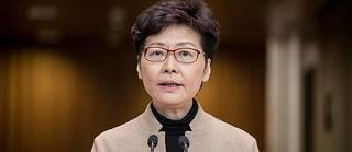 Hong Kong Chief Executive Carrie Lam speaks during a press conference in Hong Kong on November 19, 2019. - Lam said that protesters occupying a city centre university had to surrender if the three-day stand-off was to be resolved peacefully. (Photo by NICOLAS ASFOURI / AFP)