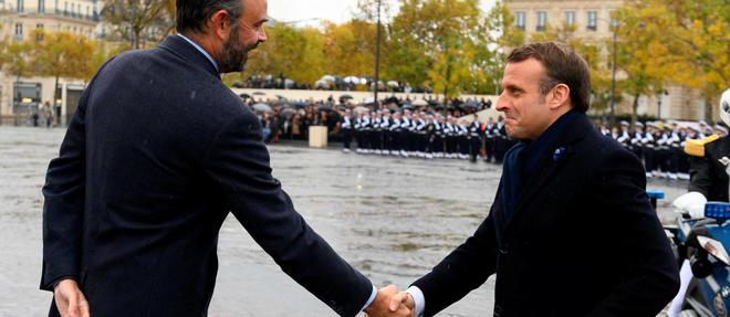 Emmanuel Macron et Édouard Philippe commémorantl'armistice du 11 novembre.