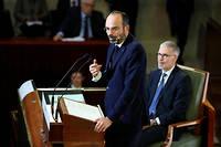 Édouard Philippe s'adresse aux partenaires sociaux au Conseil économique, social et environnemental, à Paris, le 11 décembre, pour dévoiler les arbitrages sur la réforme des retraites.