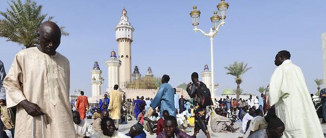 """C'est dans la ville sainte de Touba qu'est celebre tous les ans le Grand """"Magal"""" (""""celebration"""" en wolof) qui marque l'anniversaire, dans le calendrier musulman, du depart en exil le 12 aout 1895 du fondateur du mouridisme, Cheikh Ahmadou Bamba (1853-1927), dit Serigne Touba."""