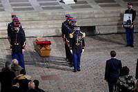 French Republican guards lay Samuel Paty's coffin inside Sorbonne University courtyard in Paris on October 21, 2020, during a national homage to French teacher Samuel Paty, who was beheaded for showing cartoons of the Prophet Mohamed in his civics class. - France pays tribute on October 21 to a history teacher beheaded for showing cartoons of the Prophet Mohamed in a lesson on free speech, an attack that has shocked the country and prompted a government crackdown on radical Islam. Seven people, including two schoolchildren, will appear before an anti-terror judge for a decision on criminal charges over the killing of 47-year-old history teacher Samuel Paty. (Photo by Francois Mori / POOL / AFP)