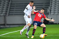 AC Milan's French defender Theo Hernandez (L) fights for the ball with Lille's French forward Jeremy Pied during the UEFA Europa League Group H football match between Lille LOSC and AC Milan at the Pierre Mauroy stadium, in Villeneuve-d'Ascq, in the outskirts of Lille, northern France on November 26, 2020. (Photo by Denis Charlet / POOL / AFP)