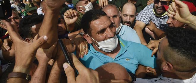 Karim Tabbou est un visage tres populaire de la contestation antiregime, Hirak, declenchee en fevrier 2019. Il a ete arrete avec trois autres voix critiques, la veille des legislatives.